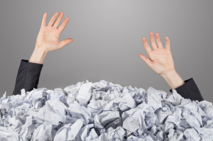 Woman buried in paper