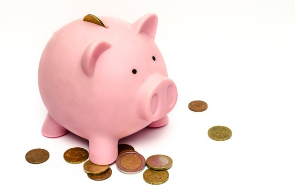 Tax Checklist. Image of Piggy bank and coins.